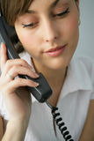 Portrait of a beautiful businesswoman. Talking on the phone in the office Stock Images