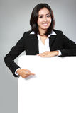 Portrait of beautiful businesswoman holding blank billboard Stock Images