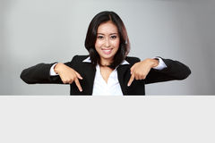 Portrait of beautiful businesswoman holding blank billboard Stock Photos