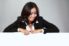 Portrait of beautiful businesswoman holding blank billboard Royalty Free Stock Photography