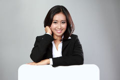Portrait of beautiful businesswoman holding blank billboard Stock Photo
