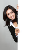 Portrait of beautiful businesswoman holding blank billboard Royalty Free Stock Photo
