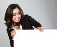 Portrait of beautiful businesswoman holding blank billboard Royalty Free Stock Images