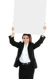 Portrait of beautiful businesswoman holding blank billboard over Stock Image