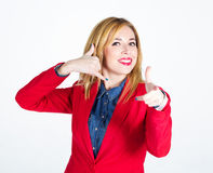 Portrait of beautiful businesswoman showing at you and making a stock photo