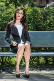 Portrait of beautiful businesswoman sitting on the bench Stock Photo