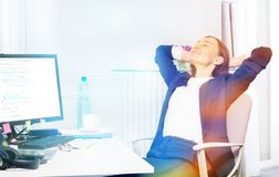 Beautiful businesswoman relaxing in the office royalty free stock photos