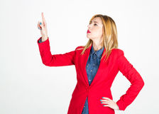 Portrait of beautiful businesswoman touching on empty space in f Royalty Free Stock Images