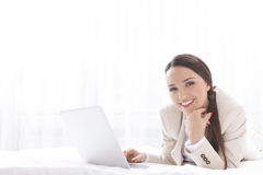 Portrait of beautiful businesswoman using laptop in hotel Royalty Free Stock Photography