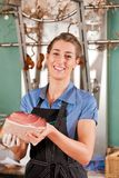 Beautiful Butcher with Raw Meat Royalty Free Stock Image
