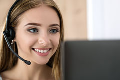 Portrait of beautiful call center operator at work Royalty Free Stock Photos