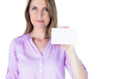 Portrait of a beautiful casual businesswoman showing a sign Royalty Free Stock Photos