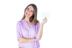 Portrait of a beautiful casual businesswoman showing a sign Royalty Free Stock Photo