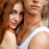 Portrait of a beautiful casual couple standing together over woo. Den background. boy hugging girl. outdoor shot Stock Image