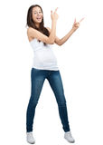 Portrait of beautiful casual girl pointing up Stock Image