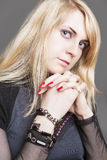 Portrait of Beautiful Caucasian Blond Female. Isolated Over Gray Royalty Free Stock Photo