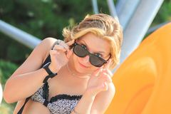 Portrait of Beautiful caucasian girl in Aquapark on Summer day. Colseup. stock photography