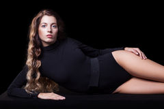 Portrait of beautiful caucasian model posing on black cloth Stock Photography