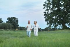 Senior couple running in field Royalty Free Stock Photography