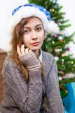 Portrait of beautiful Caucasian woman in blue Santa hat Royalty Free Stock Photos