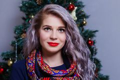 Portrait of a beautiful Caucasian woman posing against the backdrop of the Christmas tree.  royalty free stock photography