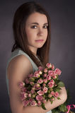 Portrait of beautiful charming brunette woman with punk flowers. Fashion photo. Portrait of beautiful dark-haired woman with flowers Royalty Free Stock Photography