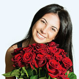 Portrait of a beautiful cheerful girl with a bouquet of roses Stock Photo