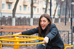 Portrait of a beautiful cheerful girl on a swing. Royalty Free Stock Photo