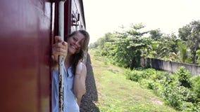 Portrait of a beautiful cheerful woman enjoying the train trip. stock video