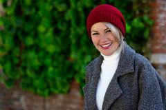 Portrait of a beautiful cheerful woman outdoors royalty free stock image