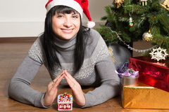 Portrait of a beautiful cheerful young woman against the backdrop of the Christmas tree Royalty Free Stock Photography