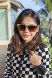 Portrait of beautiful chick fashion woman wearing sun glasses ag Stock Photography