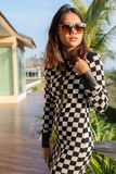 Portrait of beautiful chick fashion woman wearing sun glasses ag Royalty Free Stock Photography