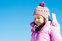 Portrait of a beautiful child. Young caucasian girl dressed up for winter, smiling Royalty Free Stock Photography