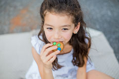 Portrait of beautiful, child (girl), bitescookies Royalty Free Stock Photography