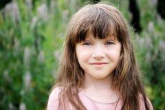 Portrait of beautiful child girl outdoors stock photo