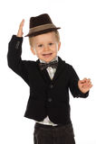Portrait of beautiful child with one hand to his hat Stock Photos