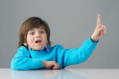 Portrait of a beautiful child raising his finger Royalty Free Stock Image