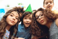 Portrait of beautiful children on holiday. Kids are celebrating birthday party. royalty free stock image