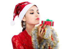 Portrait beautiful christmas woman is holding red gift in studio Stock Image