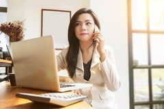 Portrait of beautiful and confident Asian business woman in work Stock Photo