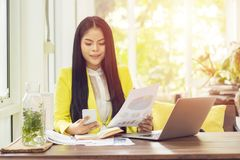 Portrait of beautiful and confident Asian business woman in working with notebook laptop and book manage job work at workplace. Happy businesswoman concept stock photo