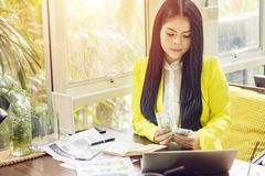 Portrait of beautiful and confident Asian business woman in working with notebook laptop and book manage job work at workplace. Happy businesswoman concept stock photos