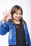 Portrait of a beautiful and confident girl showing ok sign Stock Photography