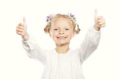 Portrait of a beautiful and confident girl showing thumbs up Stock Photography