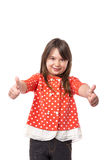 Portrait of a beautiful and confident girl showing thumbs up Stock Photos