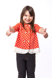 Portrait of a beautiful and confident girl showing thumbs up Royalty Free Stock Image