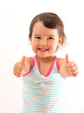 Portrait of a beautiful and confident girl showing thumbs up isolated Royalty Free Stock Images
