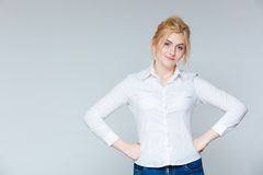 Portrait of beautiful confident young woman in white shirt. Over white background Royalty Free Stock Photo