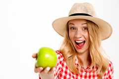 Portrait of beautiful country girl with apple over white background. Stock Images